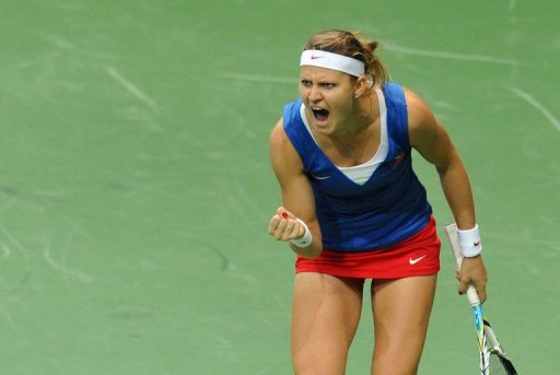 Lucie Safarova of Czech Republic reacts after winning a point against Jelena Jankovic of Serbia
