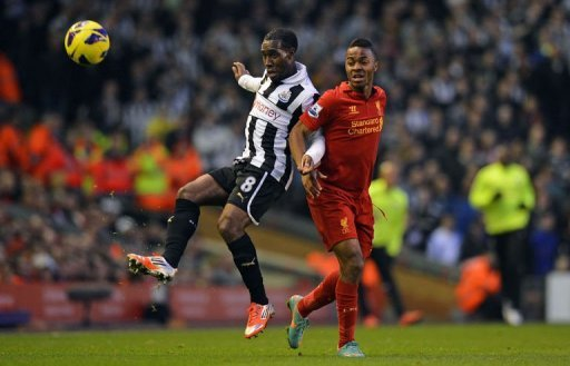 Newcastle United's Vurnon Anita (L) vies with Liverpool's Raheem Sterling (R)