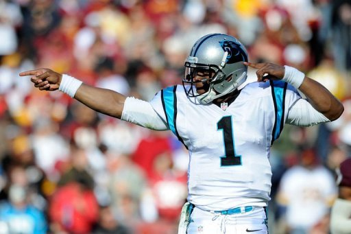Cam Newton of the Carolina Panthers celebrates after running for a first down against the Washington Redskins