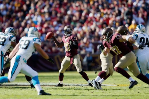 Quarterback Robert Griffin III of the Washington Redskins throws a second quarter pass against the Carolina Panthers
