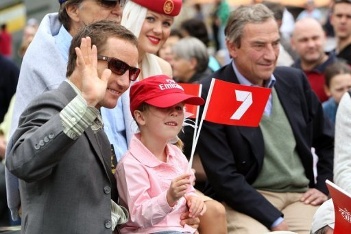 Champion Australian jockey Damien Oliver (L) is pictured with his daughter in 2008