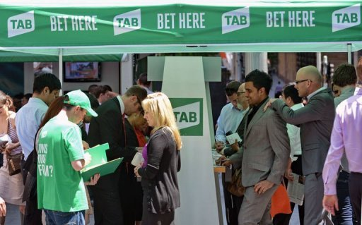 People stand outside a tent set up as a betting booth for the Melbourne Cup horse race in Sydn