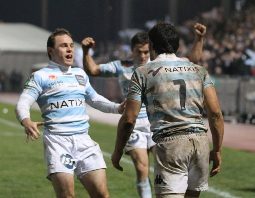Racing Metro's Julien Saubade (L) congratulates team-mate Antoine Battut (R) after a try in January