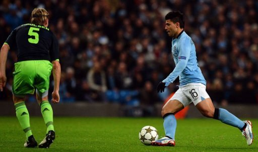 Manchester City's Sergio Aguero (R) and Ajax's Christian Poulsen