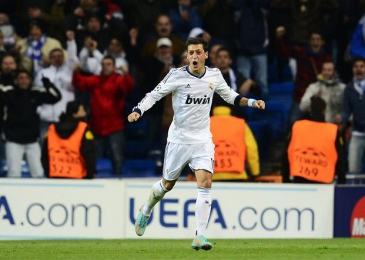 Real Madrid's Mesut Ozil celebrates after scoring