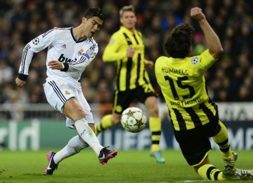Real Madrid's Cristiano Ronaldo (L) vies with Borussia Dortmund's Mats Hummels