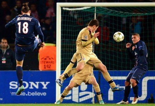 Paris Saint-Germain's Zlatan Ibrahimovic (L) shoots