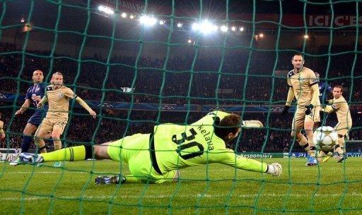 Paris Saint-Germain's Alex Costa (L) scores despite Dinamo Zagreb's goalkeeper Ivan Kelava