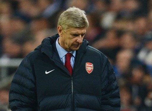 Arsenal's French head coach Arsene Wenger looks dejected during Tuesday's match away to Schalke 04