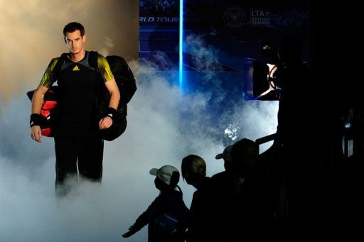 Andy Murray walks on court to play Serbia's Novak Djokovic in the ATP World Tour Finals Wednesday