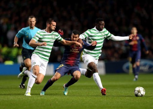 Barcelona's Pedro Rodriguez (C) trys to get between Celtic's Joe Ledley (L) and Victor Wanyama