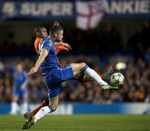 Chelsea's Gary Cahill (front) vies for the ball against Shakhtar Donetsk's Luiz Adriano