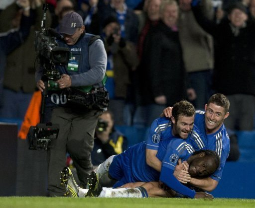 Chelsea's Victor Moses (bottom) is jumped on by teammates Gary Cahill (R) and Juan Mata (C) after scoring winning goal
