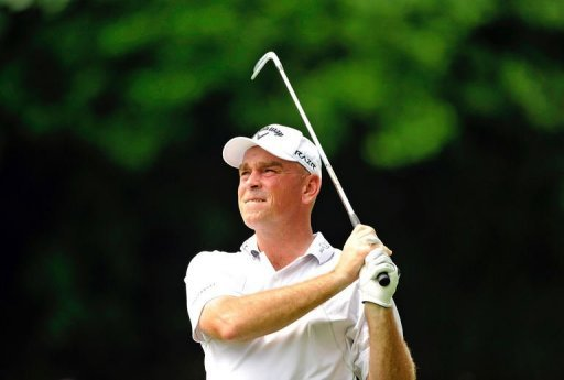 Thomas Bjorn of Denmark hits a shot on day one of the Singapore Open