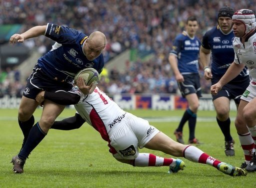 Leinster's South Africa-born Richardt Strauss (L) is tackled during the European Cup final in May