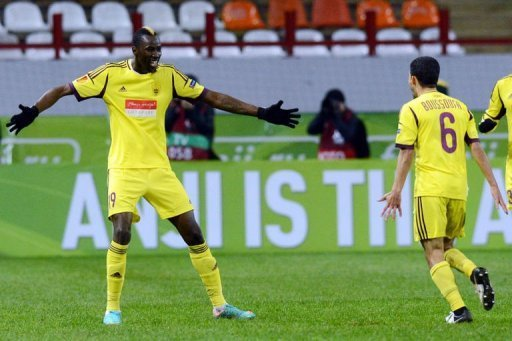 FC Anzhi Makhachkala's Lacina Traore (L) celebrates with Mbark Boussoufa after scoring