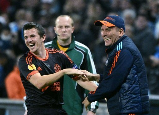 Marseille's Joey Barton (L) reacts with coach Elie Baup (R) after scoring