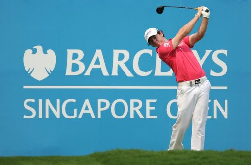 Rory McIlroy was one under par in the Singapore Open when rain halted play during the second round