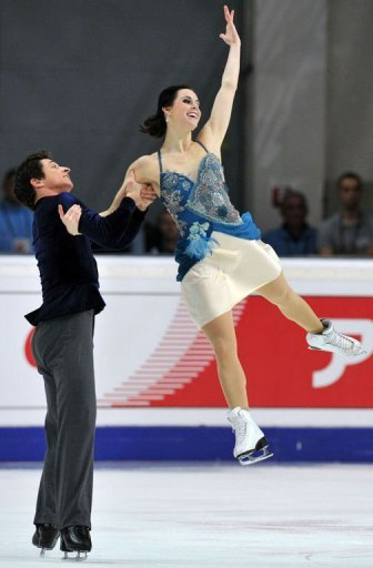 Tessa Virtue and Scott Moir of Canada perform during their ice dance short program