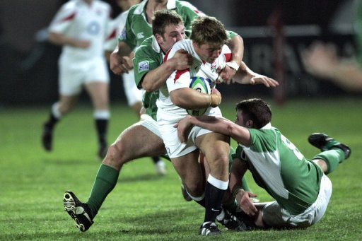 England's Tom Youngs gets tacked by Ireland's Kevin Sheahan (on the ground) and David Pollock in 2006