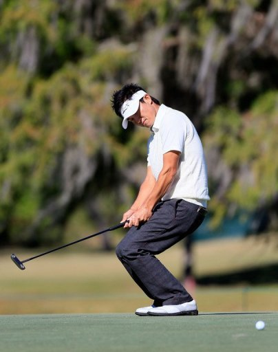 Ryuji Imada of Japan plays a shot on the 14th hole during the second round