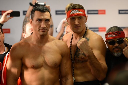 Polish challenger Wach (C) takes on Klitschko with the world champions' IBF, WBO and WBA belts on the line in Hamburg