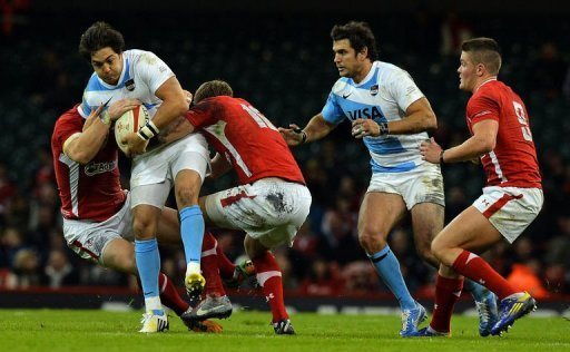 Argentina's Horacia Agulla (2nd L) is tackled by Wales players at the Millennium Stadium