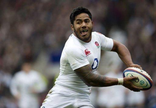 England's Manusamoa Tuilagi prepares to pass the ball