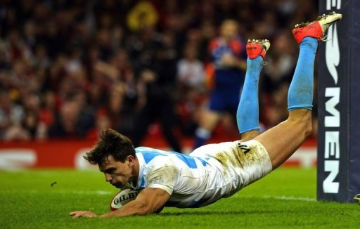 Argentina's wing Juan Imhoff scores a try