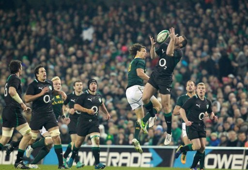 Ireland's wing Tommy Bowe (R) jumps for the ball with South Africa's full back Zane Kirchner