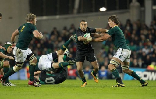 Ireland's full back Simon Zebo (2nd R) hands off South Africa's lock Eben Etzebeth (R)