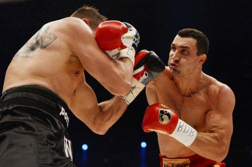 Wladimir Klitschko (R) fights with Mariusz Wach