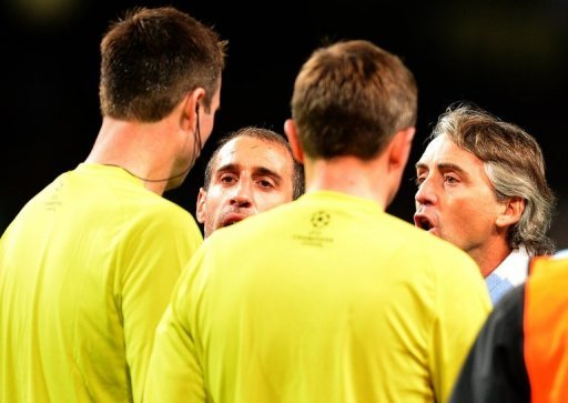 Roberto Mancini confronts the referee on the pitch at the end of the City's draw  with Ajax on Tuesday