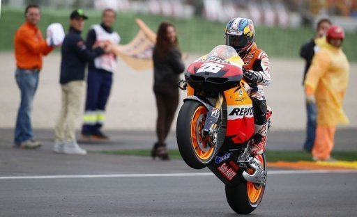 Dani Pedrosa celebrates after winning the MotoGP race at Ricardo Tormo racetrack near Valencia