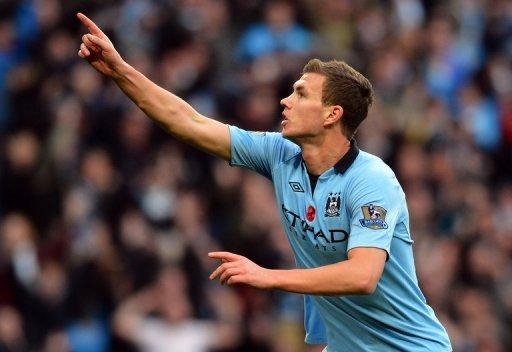 Manchester City's Bosnian Edin Dzeko celebrates scoring their second goal
