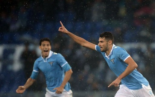 Lazio's Luis Pedro Cavanda (R) celebrates after scoring