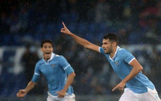Lazio's Luis Pedro Cavanda (R) celebrates after scoring
