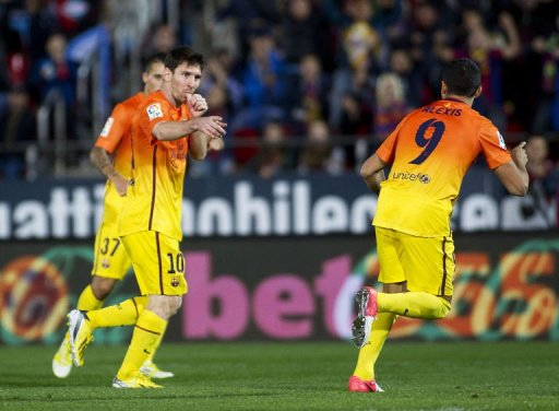 Barcelona's Lionel Messi (L) celebrates after scoring