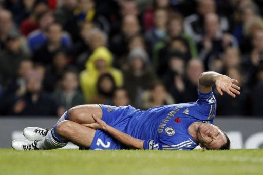 Chelsea's John Terry reacts after being injured
