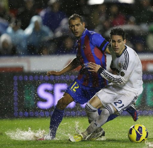 Levante's Juanfran Garcia (L) vies with Real Madrid's Jose Maria Callejon