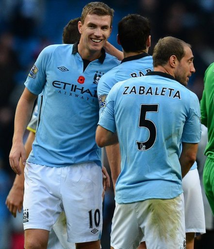 Roberto Mancini admits that Edin Dzeko (L) is not satisfied with his role as Manchester City's 'super sub'