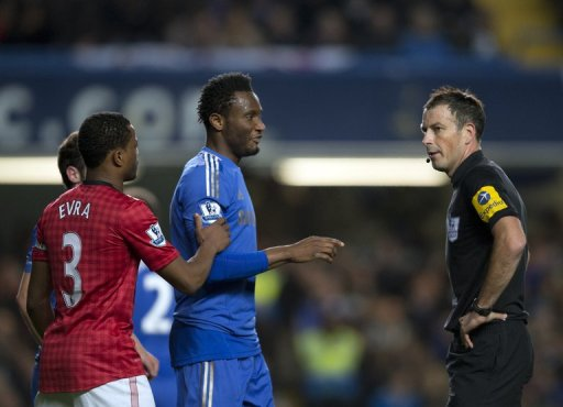 Chelsea's John Mikel Obi (2nd R) talking with referee Mark Clattenburg (R) in October