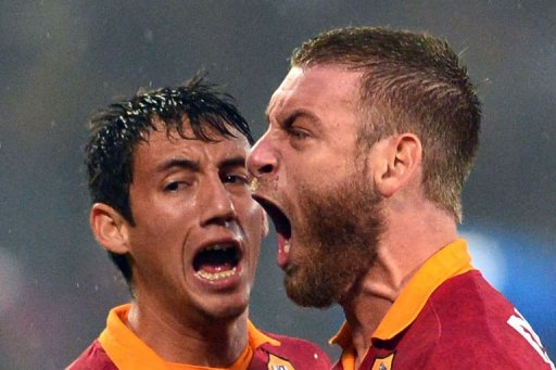 AS Roma's defender Ivan Rodrigo Piris (L) and midfielder Daniele De Rossi react during the derby