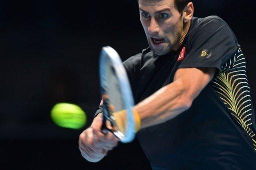 Serbia's Novak Djokovic returns against Switzerland's Roger Federer