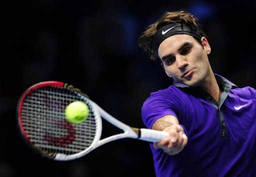 Roger Federer returns a shot by Novak Djokovic