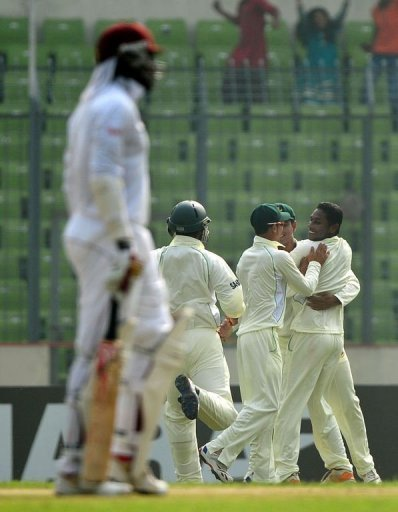 Bangladesh spinner Sohag Gazi (R) took two key wickets and a good catch against West Indies today