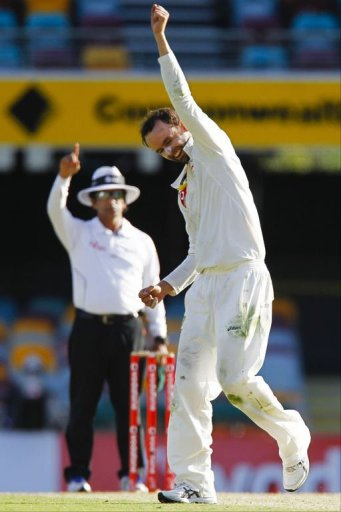 Australian bowler Nathan Lyon punches the air after claiming the wicket of South African batsman Jacques Rudolph