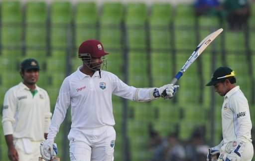 West Indies' Denesh Ramdin acknowledges the crowd after reaching his half century during the first day of the first Test