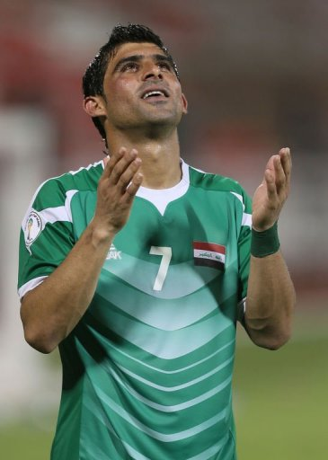 Iraq's Hammadi Ahmed celebrates after beating Jordan