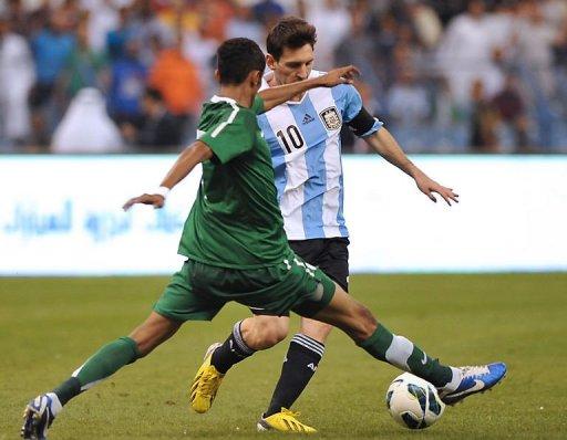 Saudi Arabia's Salman al-Faraj challenges Argentina's forward Lionel Messi (back)